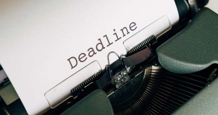Typewriter with a piece of paper that says deadline